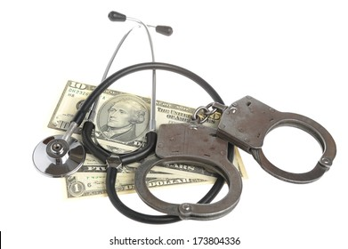 Stethoscope, handcuffs and money isolated