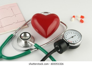 Stethoscope and heart on white background.