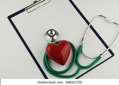 Stethoscope and heart on white background and place for your text