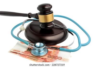 Stethoscope with judge gavel, money isolated on white background