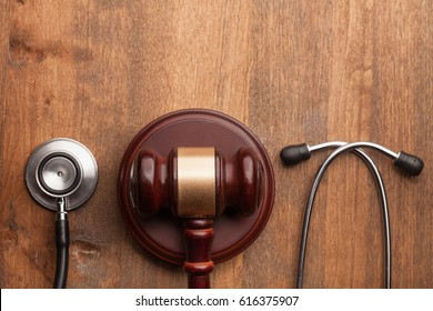 Stethoscope and judgement hammer.