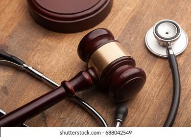 Stethoscope and judgement hammer.
