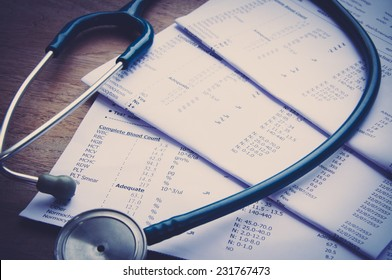 stethoscope and laboratory result, Medical insurance concept.