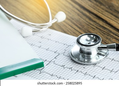 Stethoscope and medical check-up report for healthcare concept
