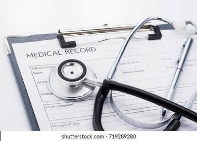 Stethoscope and medical record on white background. Result of medical. Concept image of medical care.