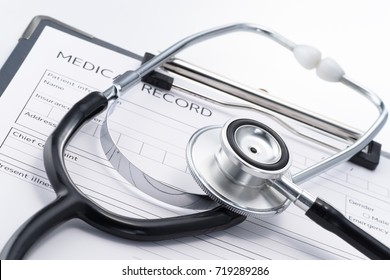 Stethoscope and medical record on white background. Concept image of health checks. Result of medical.