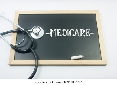 stethoscope and mini black board written medicare over white background