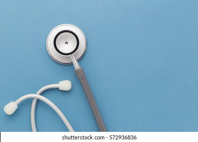 Stethoscope on blue background