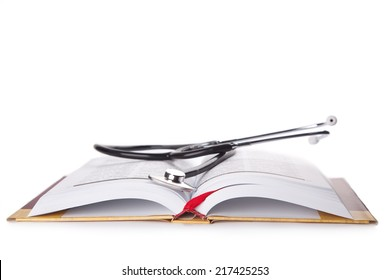 stethoscope on the book isolated