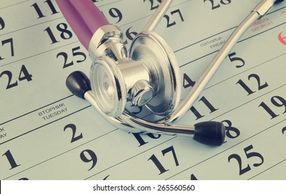 Stethoscope on calendar background, regular medical examination concept