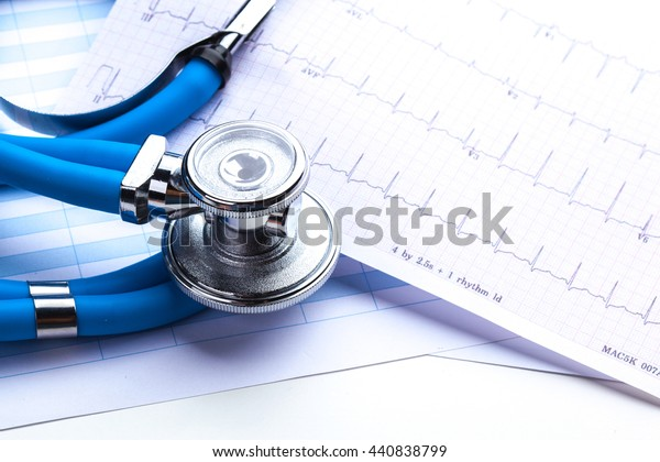 Stethoscope on cardiogram sheet