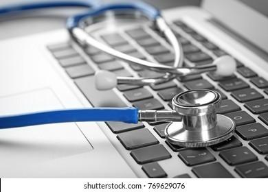 Stethoscope on computer keyboard, closeup