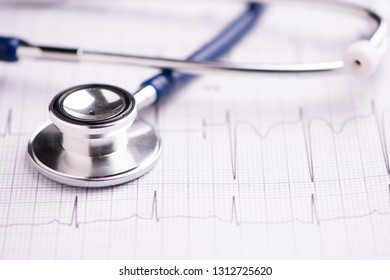 A stethoscope on ecg medical report close up