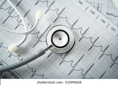 Stethoscope on EKG graph background. Medicine concept