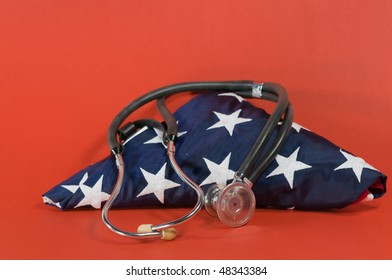 stethoscope on folded US flag with red background