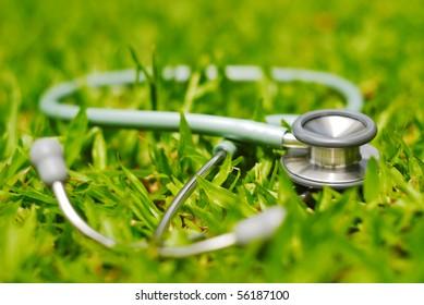 stethoscope on grass