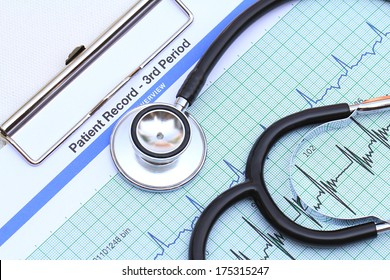 Stethoscope on heartbeat graph
