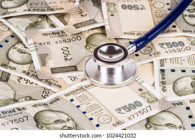 Stethoscope on Indian currency background. Conceptual image to explain rising healthcare cost