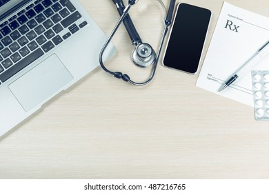 Stethoscope on laptop, close-up