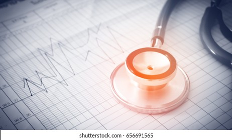 Stethoscope on paper with ecg