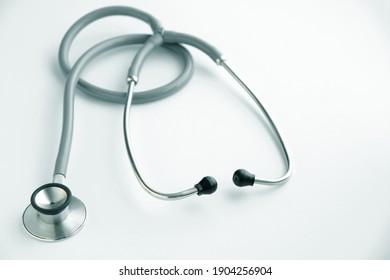 Stethoscope on white background, medical instrument