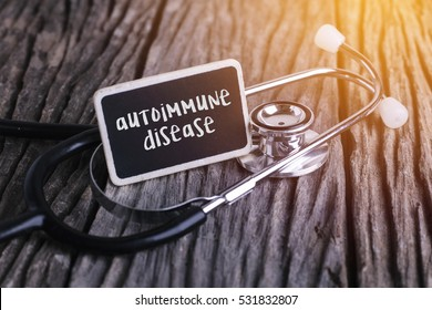 Stethoscope on wood with autoimmune disease word as medical concept