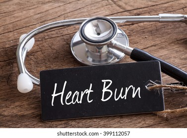 Stethoscope on wood with Heart Burn words as medical concept