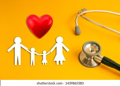 stethoscope on yellow background with family paper health medical,red heart ,insurance concept copy space