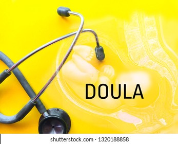 Stethoscope over yellow background written DOULA