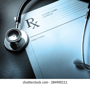 Stethoscope and patient list on metal in closeup