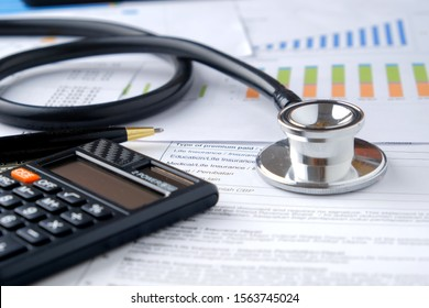 Stethoscope with Pen, Charts and Graphs, Finance, Account, Statistics, Investment, Analytic Research Data, Medical and Insurances Concept