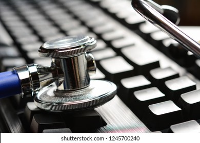 Stethoscope or phonendoscope on computer keyboard. Medical Information and technology concept, close-up