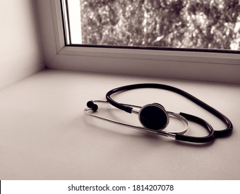 Stethoscope or phonendoscope on the doctor's window. Treatment of colds or flu.