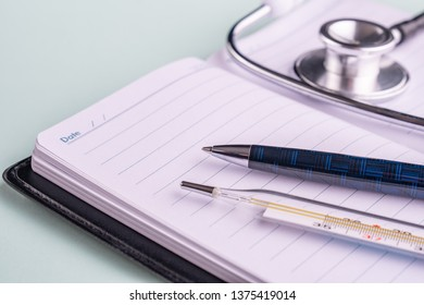 stethoscope (phonendoscope) a pen and glasses. The concept of the doctor's desktop, health