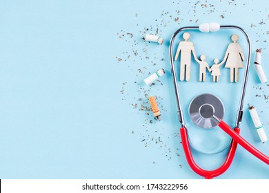 Stethoscope protect family from cigarette on light blue background. Stop smoking for your family. World No Tobacco Day concept. Copy space for advertisers.