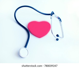 Stethoscope and red  heart. Cardiology medical background.