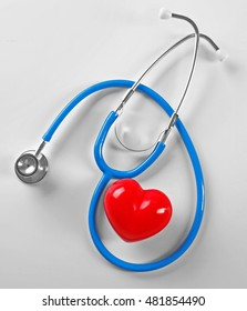 Stethoscope and red heart, isolated on white