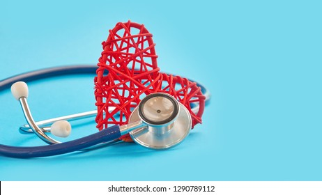 stethoscope and red heart on blue background, medical care concept, staff medical insurance