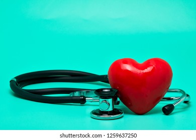 Stethoscope with red heart on a bright green background