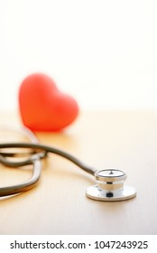 stethoscope and Red heart  on desk selective focus