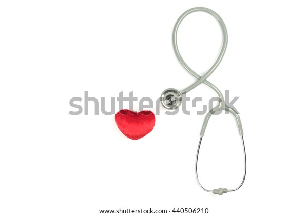 Stethoscope and red heart on white background