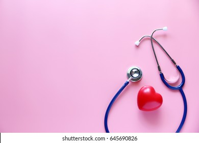 stethoscope and red heart Pink background.copy space,Concept healthcare Business