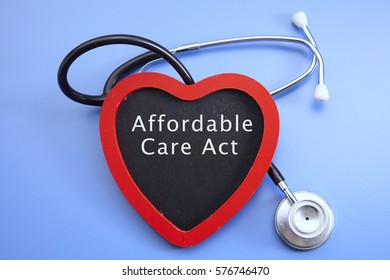 Stethoscope and red love with medical conceptual text-affordable care act