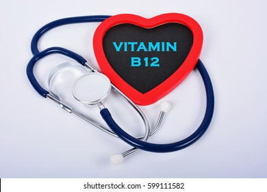 "Stethoscope and red love with medical conceptual text ""VITAMIN B12"""