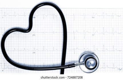 Stethoscope in the shape of heart on electrocardiogram. Tinted in blue.