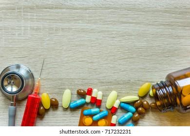 stethoscope, syringe injection and the drug tablet
