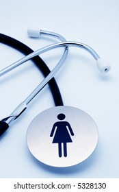 Stethoscope with universal female symbol over white background