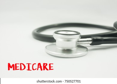 stethoscope with word Medicare over white background