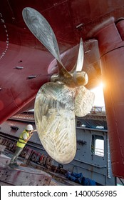 Stevedore, controller, Port Master, surveyor inspect theaft stern propeller of the ship in floating dry dock, recondition of overhaul repairing and painting, sand blasting in dry dock yard