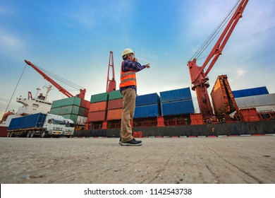 Stevedore forman, supervisor, harbour master, port captain working in charge of command in loading discharging containers shipment operation,  at port terminal